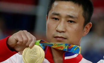 Gold medallist North Korea's Ri Se Gwang poses on the podium of the men's vault event final of the Artistic Gymnastics at the Olympic Arena during the Rio 2016 Olympic Games in Rio de Janeiro on August 15, 2016. / AFP PHOTO / Thomas COEXTHOMAS COEX/AFP/Getty Images