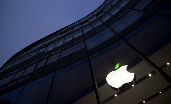 A green leaf adorns the Apple logo on 'Earth Day' at the company's Koe-Bogen store on April 22, 2015 in Duesseldorf, Germany. This day aims to strengthen the appreciation of the natural environment. Apple also added a new Earth Day 2015 section to the App Store which highlights content that contribute to environmental awareness, as well as apps that promote green living and going paperless.