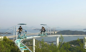 KURASHIKI, JAPAN - APRIL 27:  Tourist ride the pedal-powered sky cycle roller coasters at Washuzan Highland Amusement Park on April 27, 2013 in Kurashiki, Japan.  Washuzan Highland Amusement park is located in Kurashiki area looking over a panoramic view of islands floating on the Seto Inland Sea.  (Photo by Buddhika Weerasinghe/Getty Images)